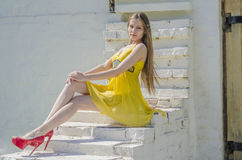 Young slim woman on old stone stairs Stock Photos