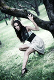 Young slim woman in a park Stock Photography