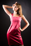 Young slim woman in pink dress Royalty Free Stock Image