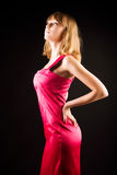 Young slim woman in pink dress Stock Image