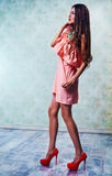 Young slim woman in pink dress Royalty Free Stock Images
