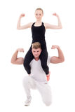 Young slim woman sitting on shoulders of her muscular boyfriend Stock Images