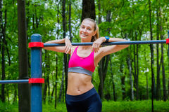 Young slim woman sports portrait on the training ground Royalty Free Stock Photos