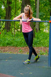 Young slim woman sports portrait on the training ground. In a park Royalty Free Stock Images