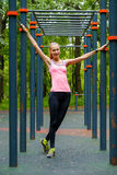 Young slim woman sports portrait on the training ground. In a park Royalty Free Stock Photography