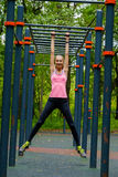 Young slim woman sports portrait on the training ground. In a park Stock Image