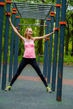 Young slim woman sports portrait on the training ground. In a park Royalty Free Stock Photo