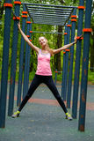 Young slim woman sports portrait on the training ground. In a park Stock Images