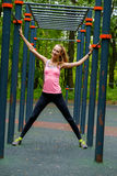 Young slim woman sports portrait on the training ground. In a park Stock Photo