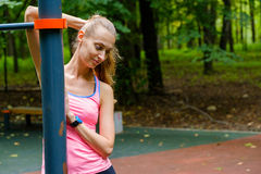 Young slim woman sports portrait on the training ground. In a park Royalty Free Stock Photos