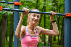 Young slim woman sports portrait on the training ground. In a park Stock Photos