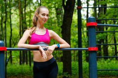 Young slim woman sports portrait on the training ground. In a park Royalty Free Stock Image