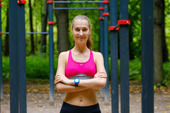 Young slim woman sports portrait on the training ground. In a park Stock Photography