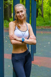 Young slim woman sports portrait on the training ground Royalty Free Stock Images