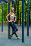 Young slim woman sports portrait on the training ground Royalty Free Stock Image