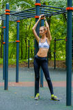 Young slim woman sports portrait on the training ground Stock Photo