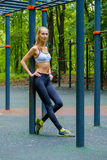 Young slim woman sports portrait on the training ground Royalty Free Stock Photo