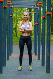Young slim woman sports portrait on the training ground Stock Photos