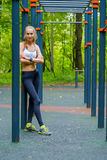 Young slim woman sports portrait on the training ground Stock Images