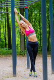 Young slim woman sports portrait on the training ground Royalty Free Stock Photography