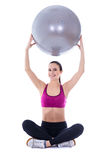 Young slim woman in sports wear sitting with fitness ball isolat Royalty Free Stock Photo