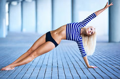 Young slim woman stretching Royalty Free Stock Photo