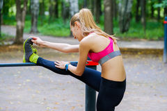 Young slim woman stretching in a training ground Stock Photo