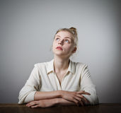 Young slim woman is thinking Royalty Free Stock Photos