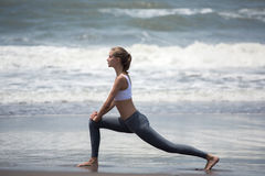 Young slim woman training on the beach. Royalty Free Stock Images