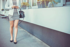 Young slim woman walking by the street wearing high heels Royalty Free Stock Photos