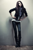 Young slim woman on wall background Royalty Free Stock Image