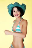 Young slim woman wearing swimwear and summer hat Stock Photography