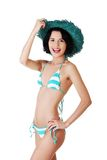 Young slim woman wearing swimwear and summer hat Royalty Free Stock Image