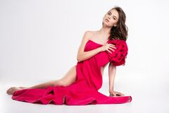 Young Slim Woman With A Naked Body Hides It A Pink Dress. Portrait Of An Young Beautiful Woman Covers A Part Of Her Slim Nude Sexy Stock Photo
