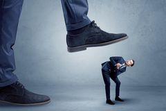 Trampled small businessman in suit stock photography