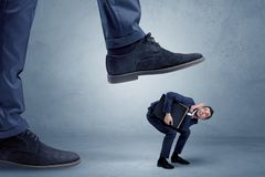 Trampled small businessman in suit stock photo