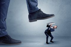 Trampled small businessman in suit stock image