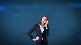 Young smart beautiful businesswoman thinking or imagining something, concept. Stock Images