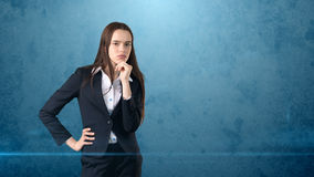 Young smart beautiful businesswoman thinking or imagining something, concept. Stock Image