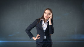 Young smart beautiful businesswoman thinking or imagining something, concept. Royalty Free Stock Image