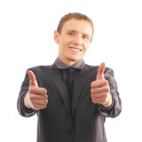 A young and smart businessman holding thumbs up Royalty Free Stock Photos