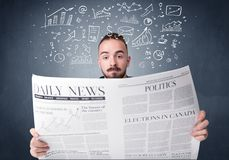 Businessman reading newspaper. Young smart businessman reading daily newspaper with business plan graphics above his head Royalty Free Stock Photos