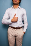 Young smart man giving thumbs up Stock Images