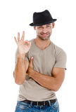 Young smart man indicating OK sign Royalty Free Stock Photos
