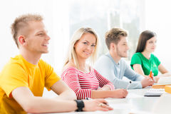 Young and smart students learning in a classroom Stock Images