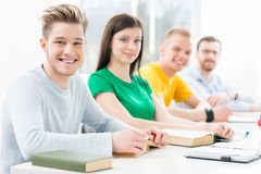 Young and smart students learning in a classroom Royalty Free Stock Image