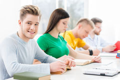 Young and smart students learning in a classroom Stock Image