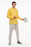 Young smash director holding money. Royalty Free Stock Photography