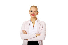 Young smile business woman with covering arms.  Royalty Free Stock Photos