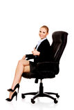 Young smile business woman sitting on a chair in office Stock Photography
